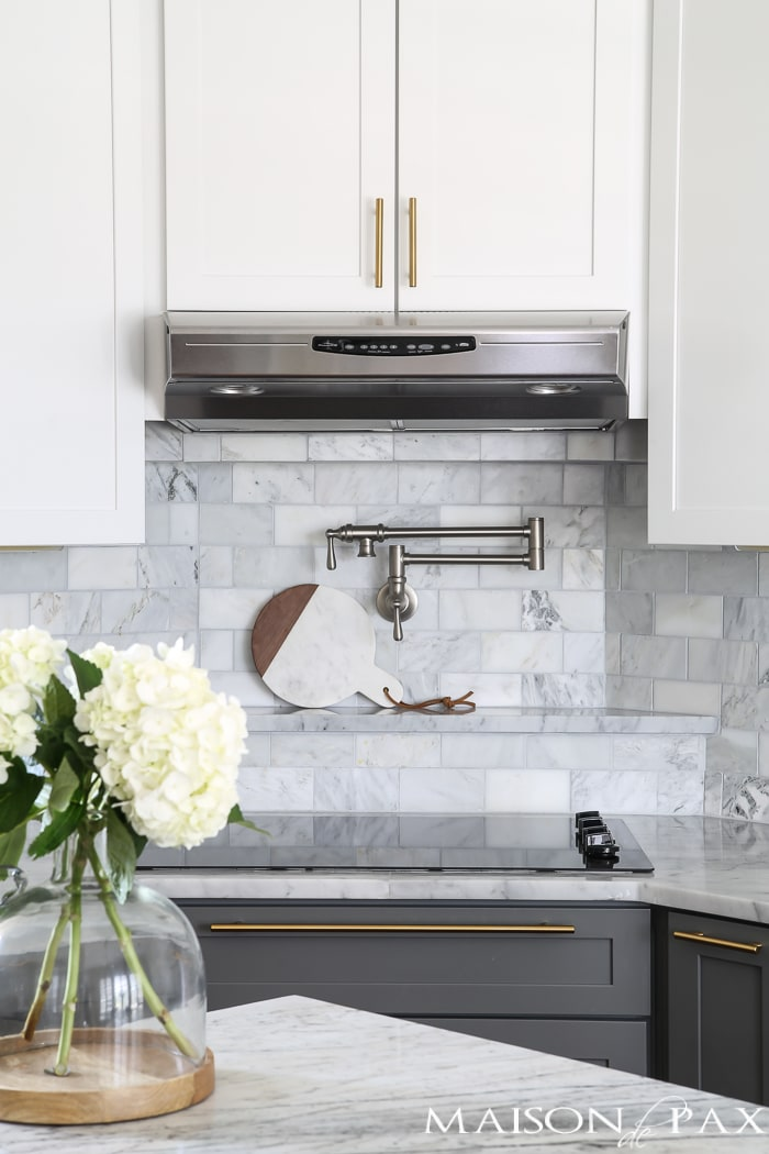 Two-toned gray and white cabinet with marble subway tile- Maison de Pax