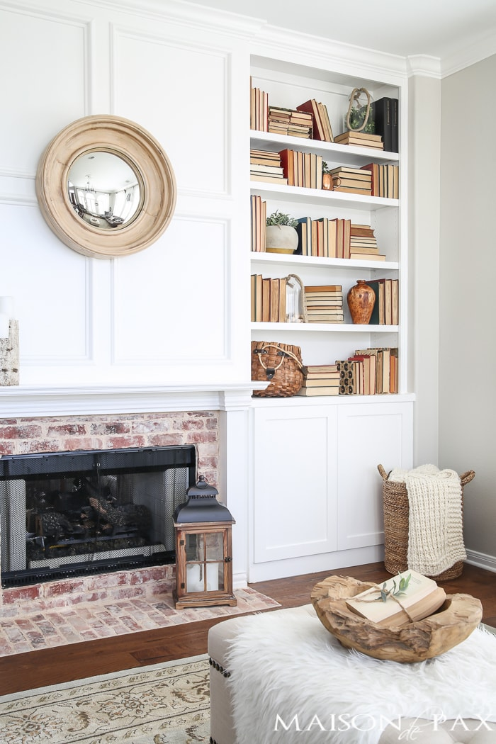 Antique brick fireplace and neutral bookshelf- Maison de Pax