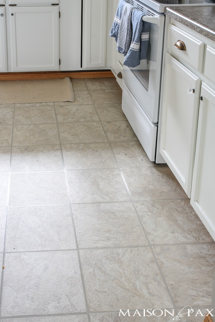 Tired of your old linoleum floors?!?! Try this incredible budget-friendly transformation to get wood-look floors perfect for high-traffic areas!
