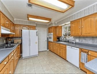 Old kitchen with oak cabinets- Maison de Pax