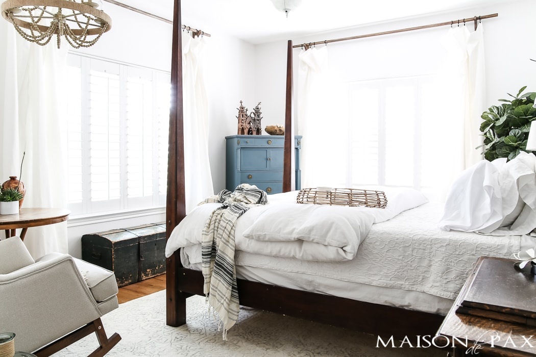 Relaxed, natural, neutral master bedroom with lots of white and touches of boho texture... the perfect retreat!