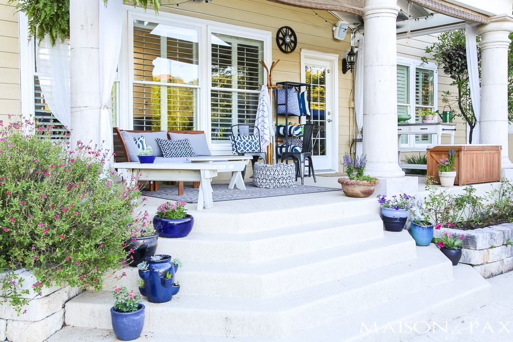 Painted porch with planters and outdoor furniture- Maison de Pax