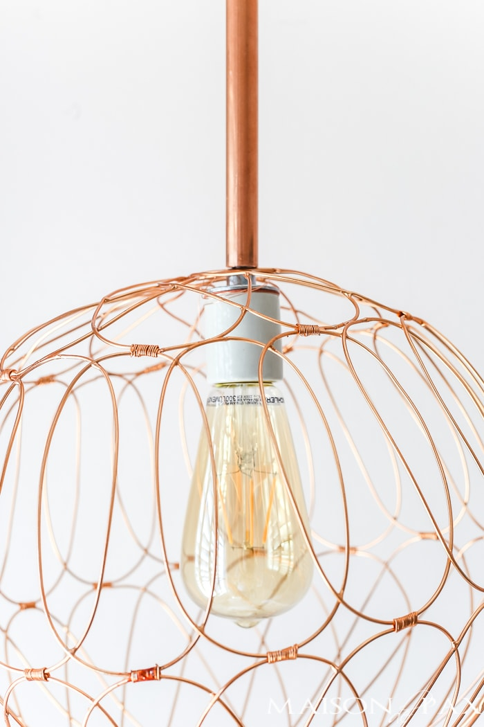 Step by Step instructions (with clear picture tutorial) for how to make a DIY copper pendant light fixture. Just gorgeous in any space and so versatile!
