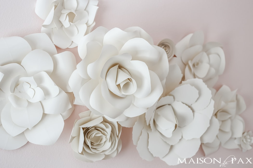 Paper flowers on pink wall- Maison de Pax