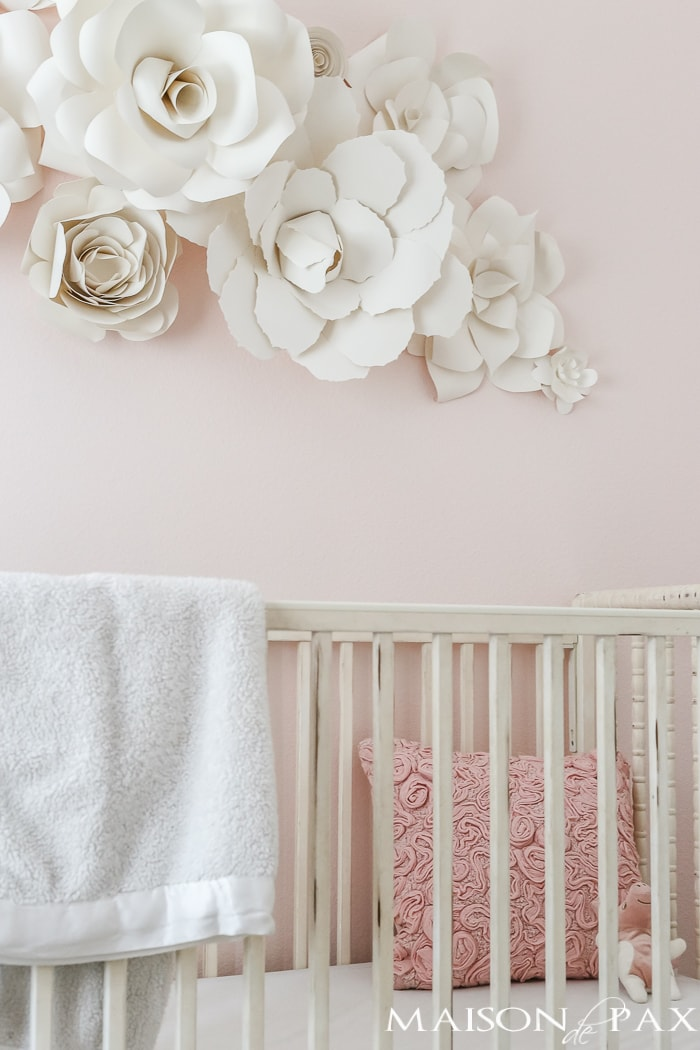 Paper flowers above the crib- Maison de Pax