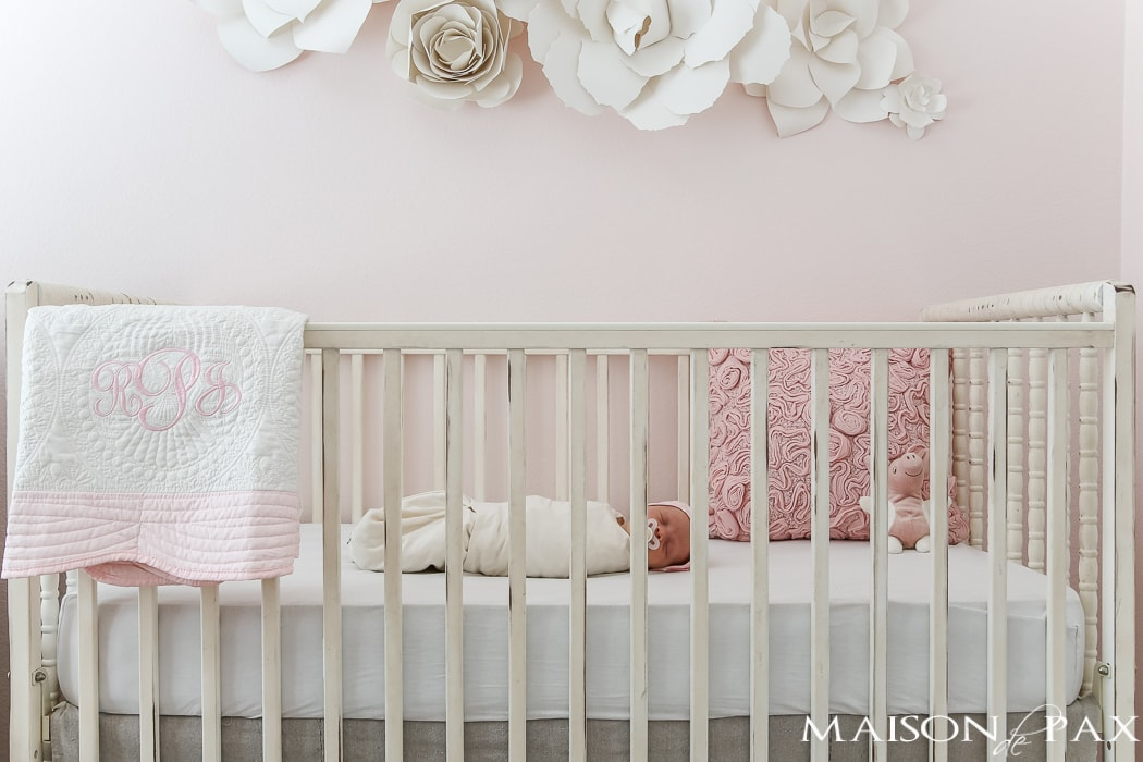 baby girl in painted crib- Maison de Pax