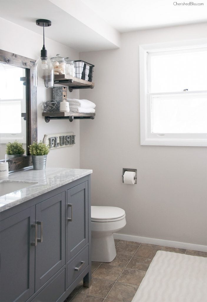 industrial farmhouse style bathroom: paint bathroom cabinets a deep gray to get this look! Such an affordable bathroom makeover idea