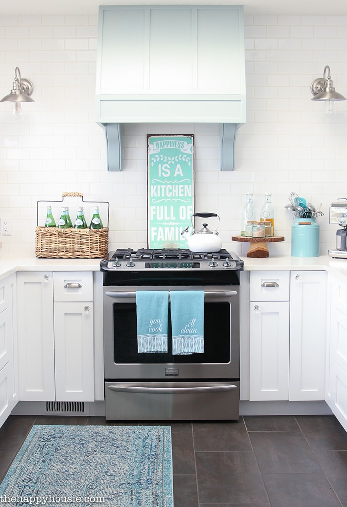A Happy Kitchen: such a gorgeous aqua and white kitchen with beautiful, white counters and many diy elements