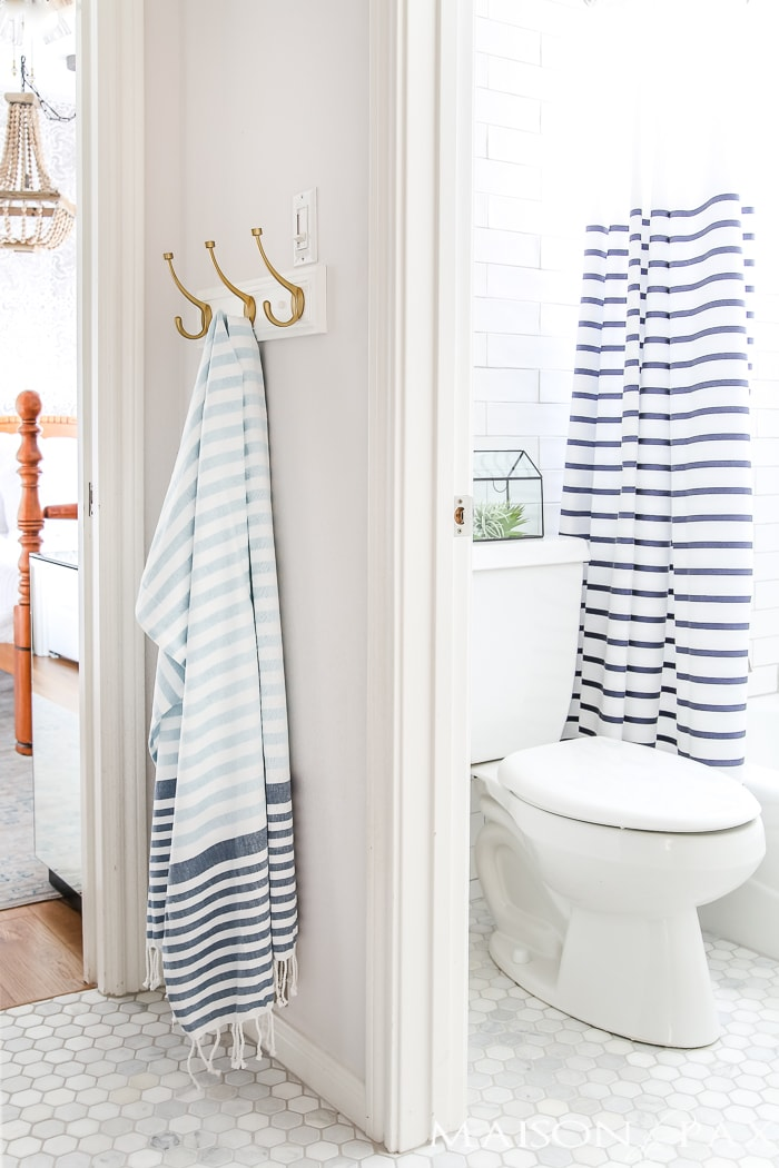 blue and white striped turkish towels and shower curtain give this bathroom a slight nautical feel