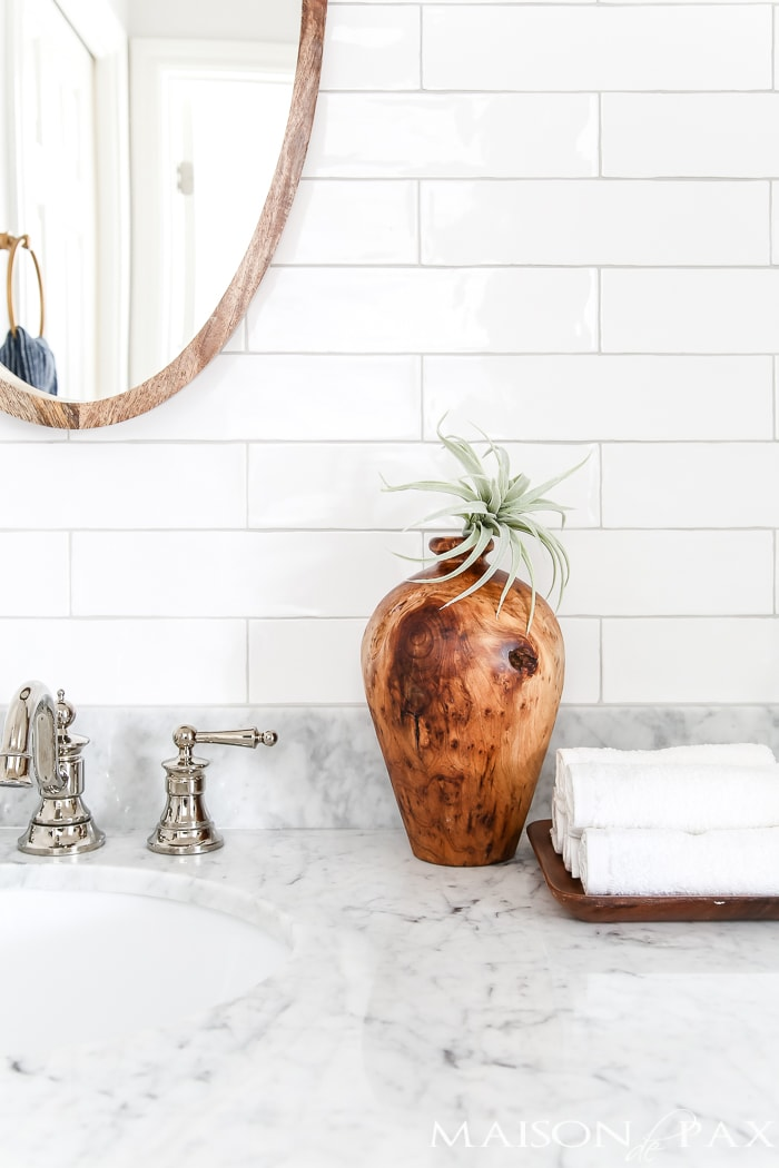 Navy and white bathroom with brass and wood accents: Find out where to find affordable sources for a bathroom remodel like this!