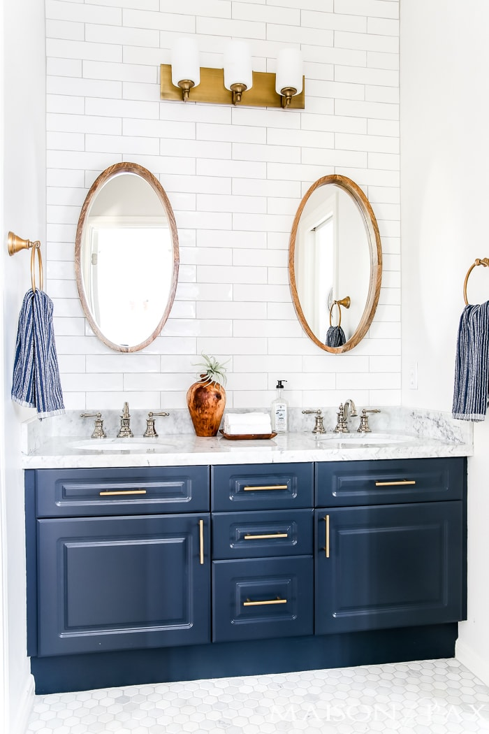 navy and white bathroom with brass and wood accents find out where to find affordable - Bathroom Designs Jack And Jill