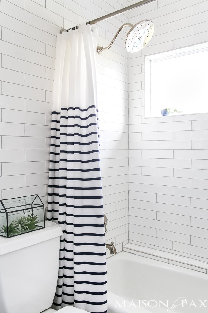 Navy and white bathroom with brass and wood accents: gorgeous rain head shower set!