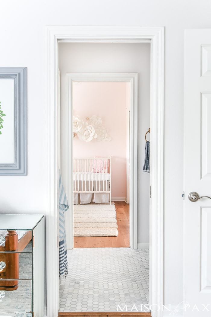 jack and jill bath with marble hex flooring is perfect between these two little girls' rooms