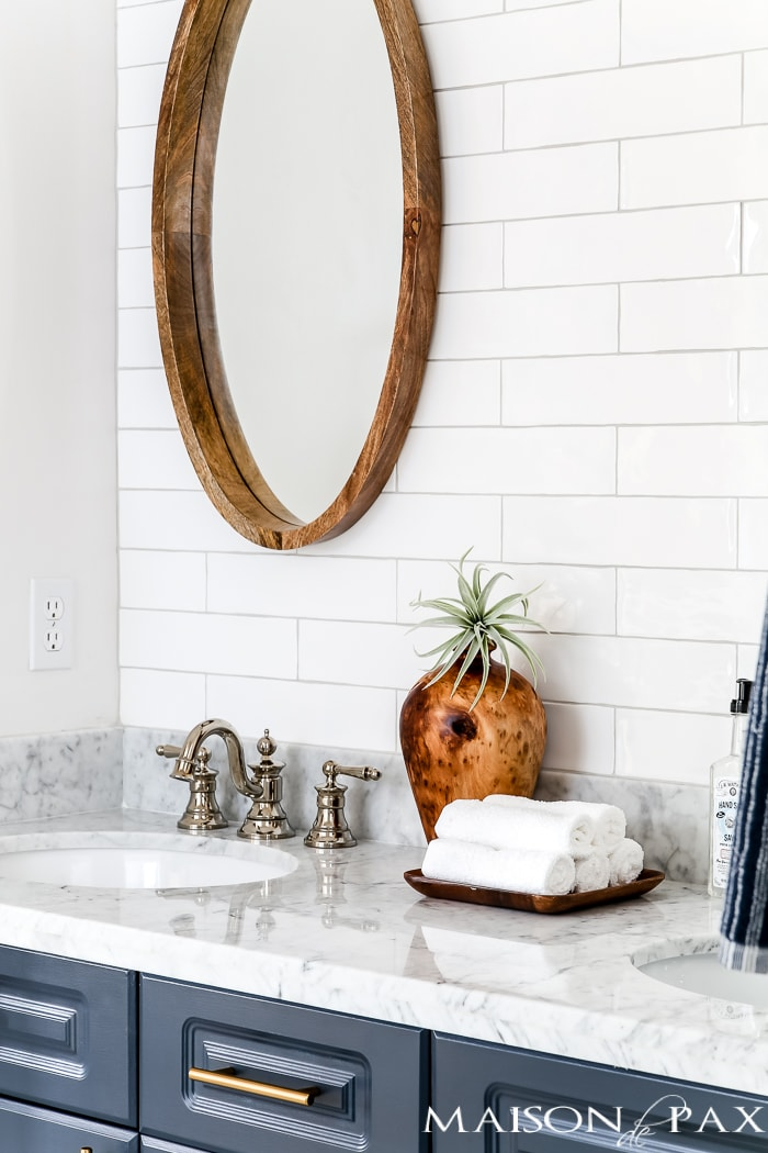polished nickel faucets are classic and timeless in this chick, modern bathroom