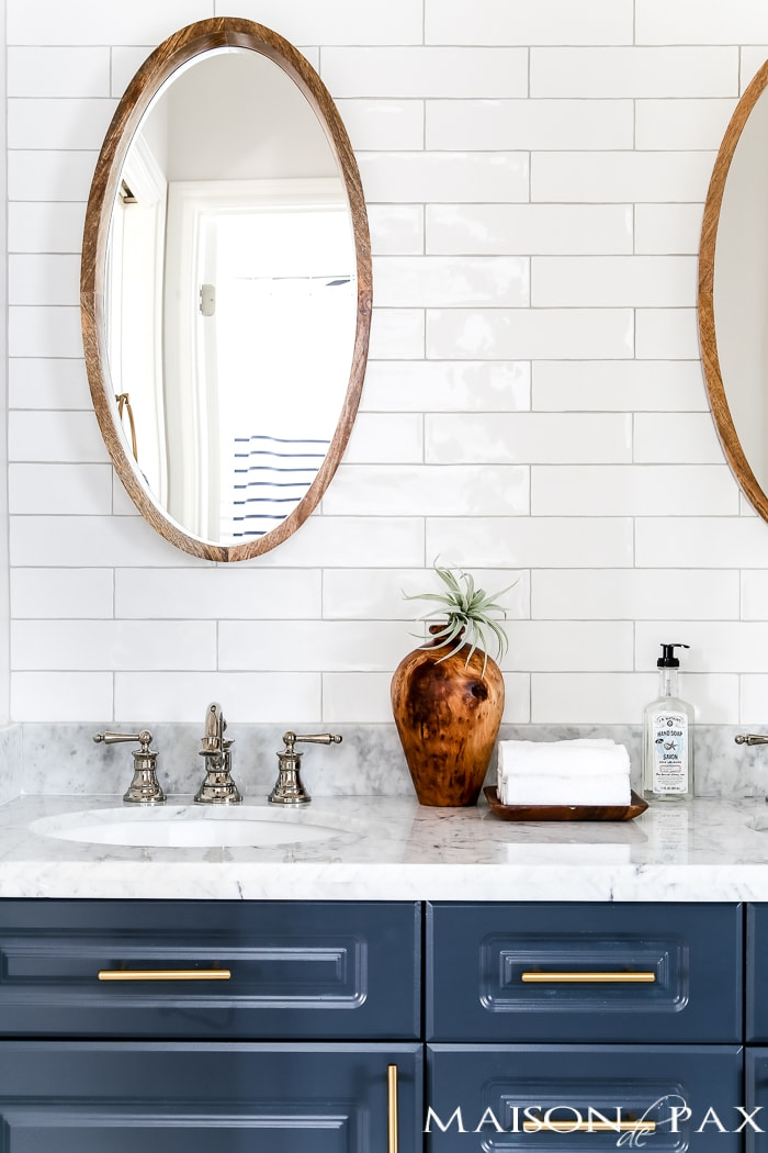 sophisticated jack and jill bathroom with floor to ceiling tile- Maison de Pax