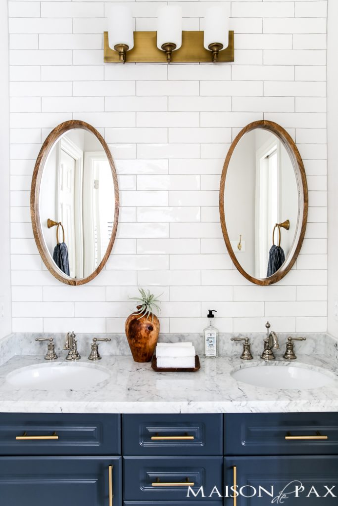 1990s home renovation: classic yet modern bathroom with white tile and navy vanity | Maison de Pax