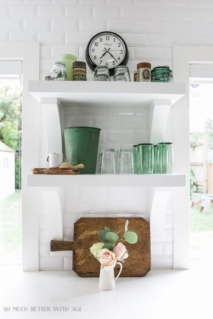 French vintage style: antique green glass and simple flower arrangements. Get more tips on how to get the look!