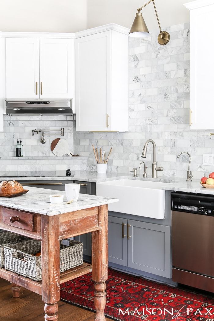 Is etching a problem with marble counters? Should I use marble in the kitchen?  It's one of the most common questions for today's kitchen design!  Read all about the pros and cons of marble countertops as well as what it is like living with honed marble countertops in a household with kids. #carraramarble #marblebacksplash #marblecountertops #marblecounters #marblekitchen