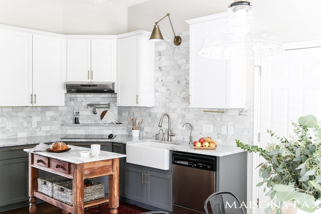 living with marble countertops with kids: Should I use marble in the kitchen?  It's one of the most common questions for today's kitchen design!  Read all about the pros and cons of marble countertops as well as what it is like living with honed marble countertops in a household with kids. #carraramarble #marblebacksplash #marblecountertops #marblecounters #marblekitchen