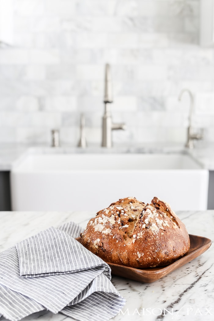 marble kitchen with warm, fresh loaf of bread #marblekitchen