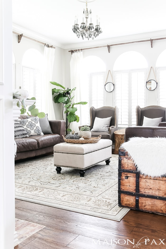 fall living room with fur accents and white pumpkins #falldecorating