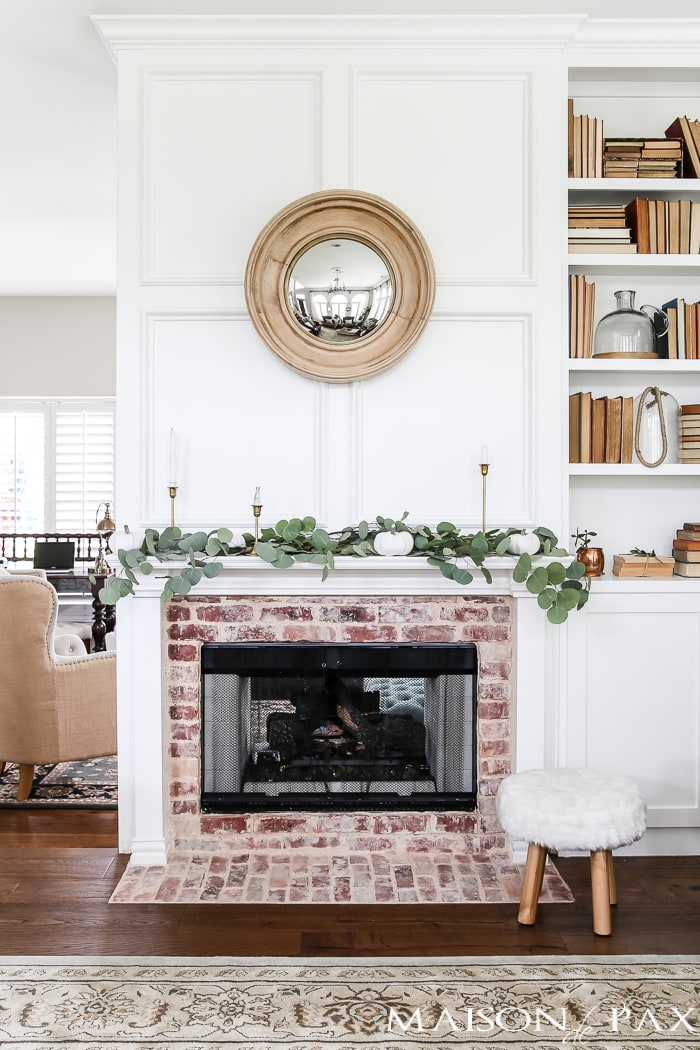 eucalyptus and white pumpkins make a gorgeous fall mantel #fallmantel