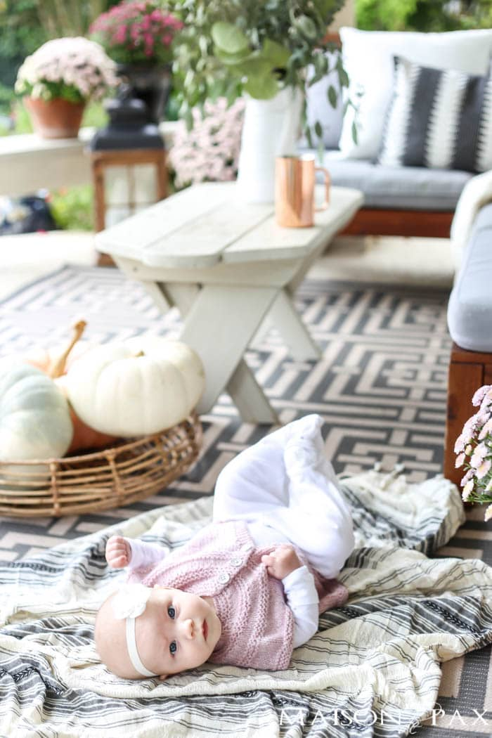 pastel pumpkins and fresh eucalyptus make this gorgeous outdoor living space ready for fall