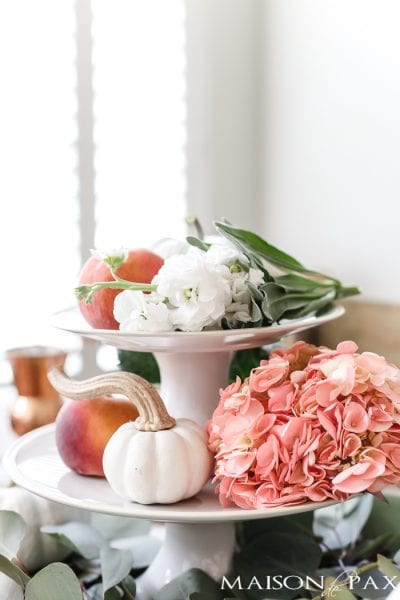fall centerpiece: tiered cake stand with pumpkins and peaches #fallcenterpiece