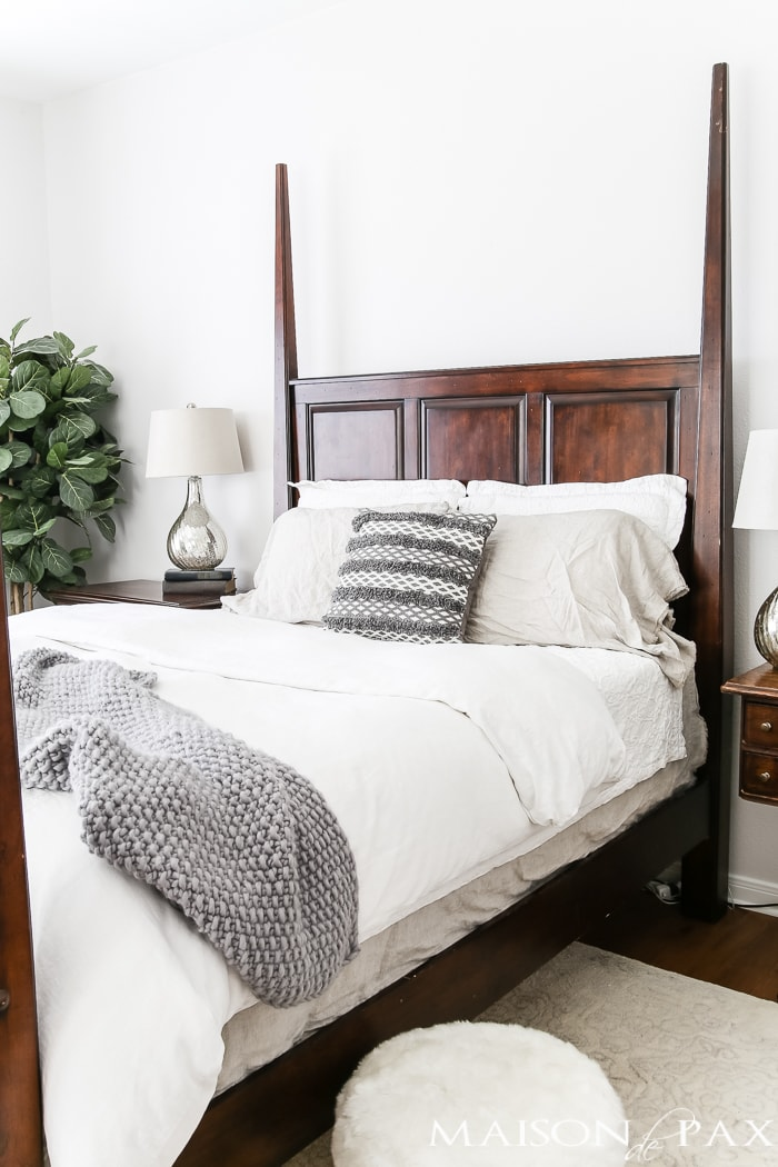 white bedding and dark gray accents- Maison de Pax