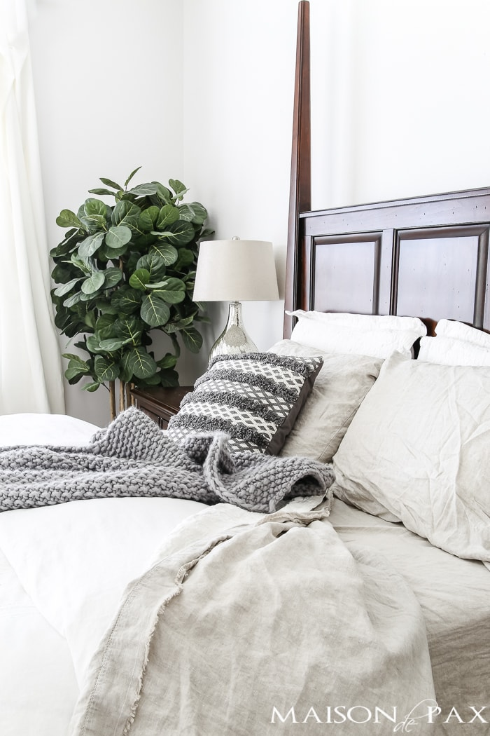 linen sheets and textured gray pillow and throw accent- Maison de Pax