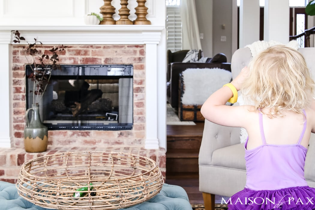 simple, neutral fall mantel decor ideas: let your kid help decorate!