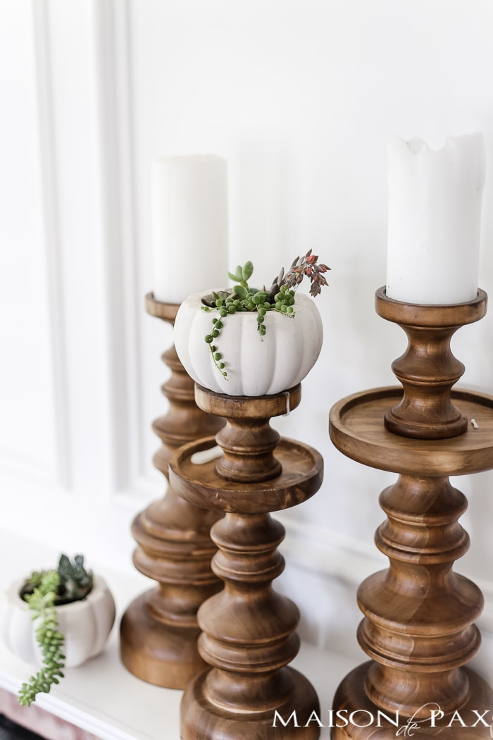 simple, neutral fall mantel decor ideas: succulent pumpkins and elegant wood candlesticks