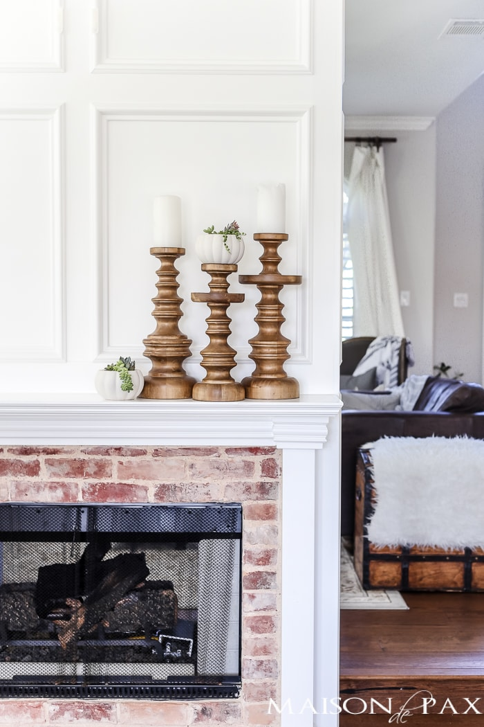 simple, neutral fall mantel decor ideas: beautiful antique brick and white molding above the mantel