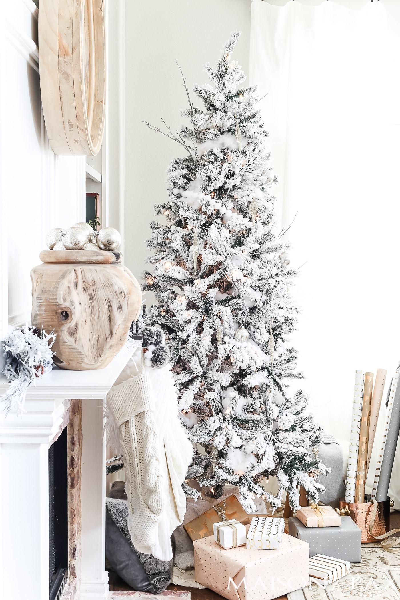 white and cream and blush Christmas decorations: mantel, flocked tree, stockings #neutralChristmasdecor