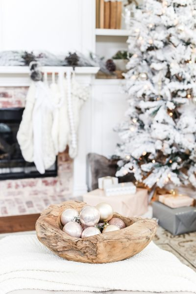blush ornaments in a raw wood bowl make gorgeous neutral holiday decor #holidaydecorating