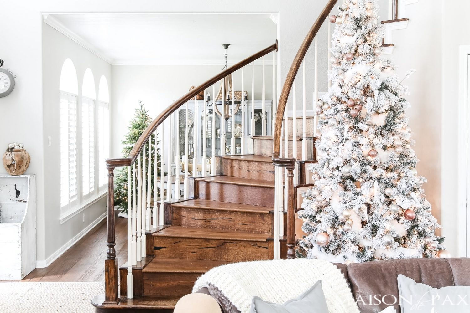 light, bright holiday home: flocked tree and blush copper decorations #christmastree