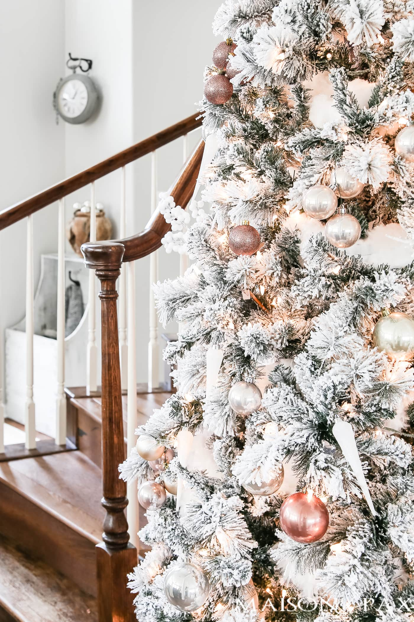 blush and copper and icicle white ornaments on a full flocked tree #flockedtree