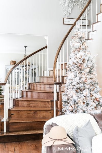 This blush flocked Christmas tree is a soft, almost neutral spin on a traditional holiday tree.  Find out how to get the look of this blush Christmas tree the easy way! #blushchristmastree