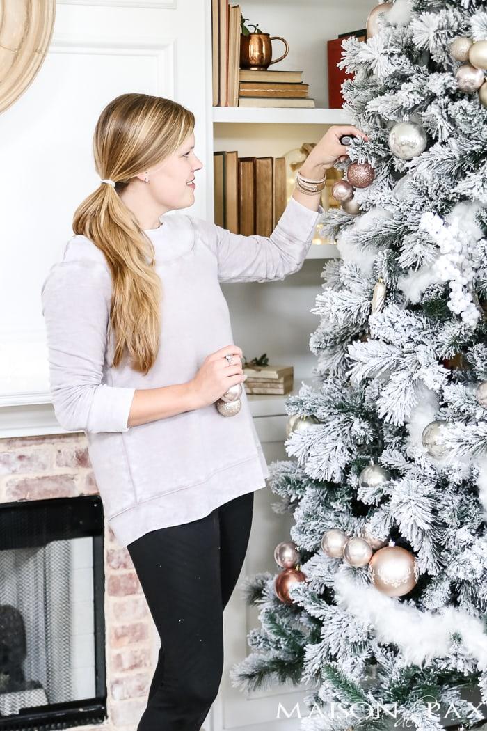flocked tree beside fireplace #christmastree