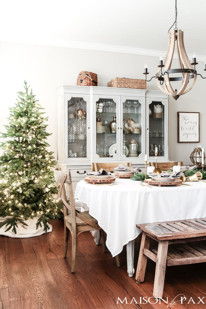 simple green tree and white tablecloth and natural centerpiece make this the perfect farmhouse Christmas dining room and holiday tablescape - Maison de Pax