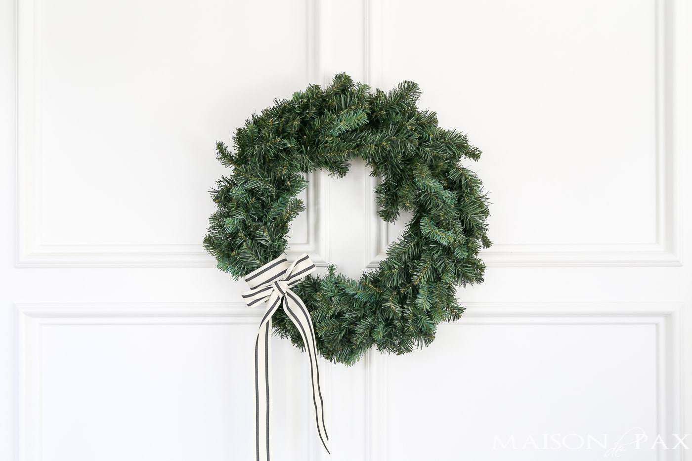 wrap a pretty ribbon onto a cheap wreath to great a gorgeous, expensive look (and click for 4 other easy, affordable wreath ideas!) #christmaswreath