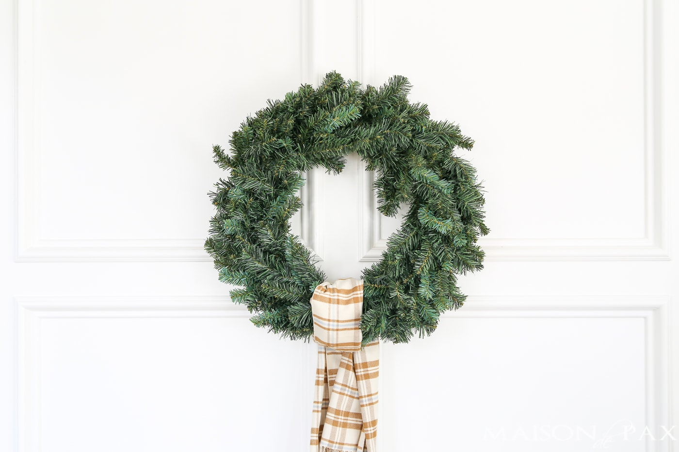 tie a plaid scarf onto a cheap wreath to great a gorgeous, expensive look (and click for 4 other easy, affordable wreath ideas!) #christmaswreath