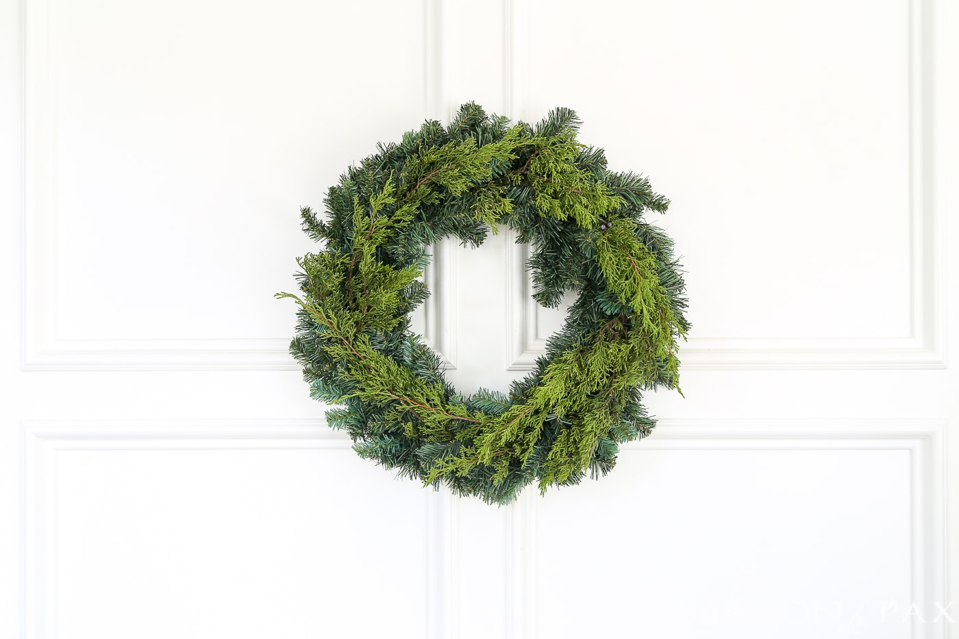 insert fresh greens into a cheap wreath to great a gorgeous, expensive look (and click for 4 other easy, affordable wreath ideas!) #christmaswreath