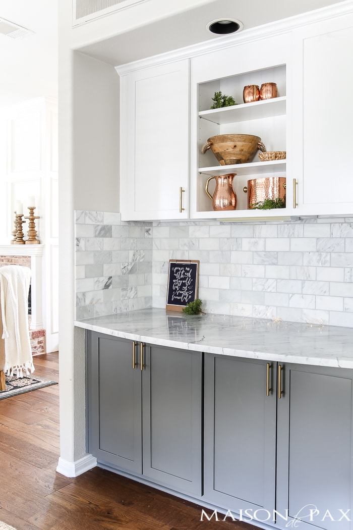 Marble bar area: Should I use marble in the kitchen?  It's one of the most common questions for today's kitchen design!  Read all about the pros and cons of marble countertops as well as what it is like living with honed marble countertops in a household with kids. #carraramarble #marblebacksplash #marblecountertops #marblecounters #marblekitchen