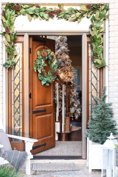 southern style winter porch: magnolia wreath and garland, adirondack chair, cozy accents #winterporch