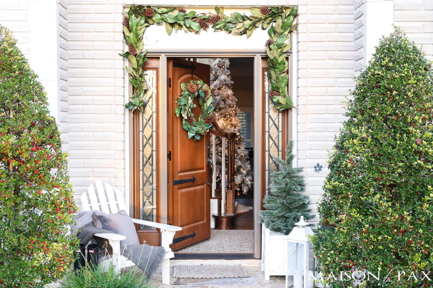 southern style winter porch magnolia wreath and garland adirondack chair cozy accents - Decorating Adirondack Chairs For Christmas