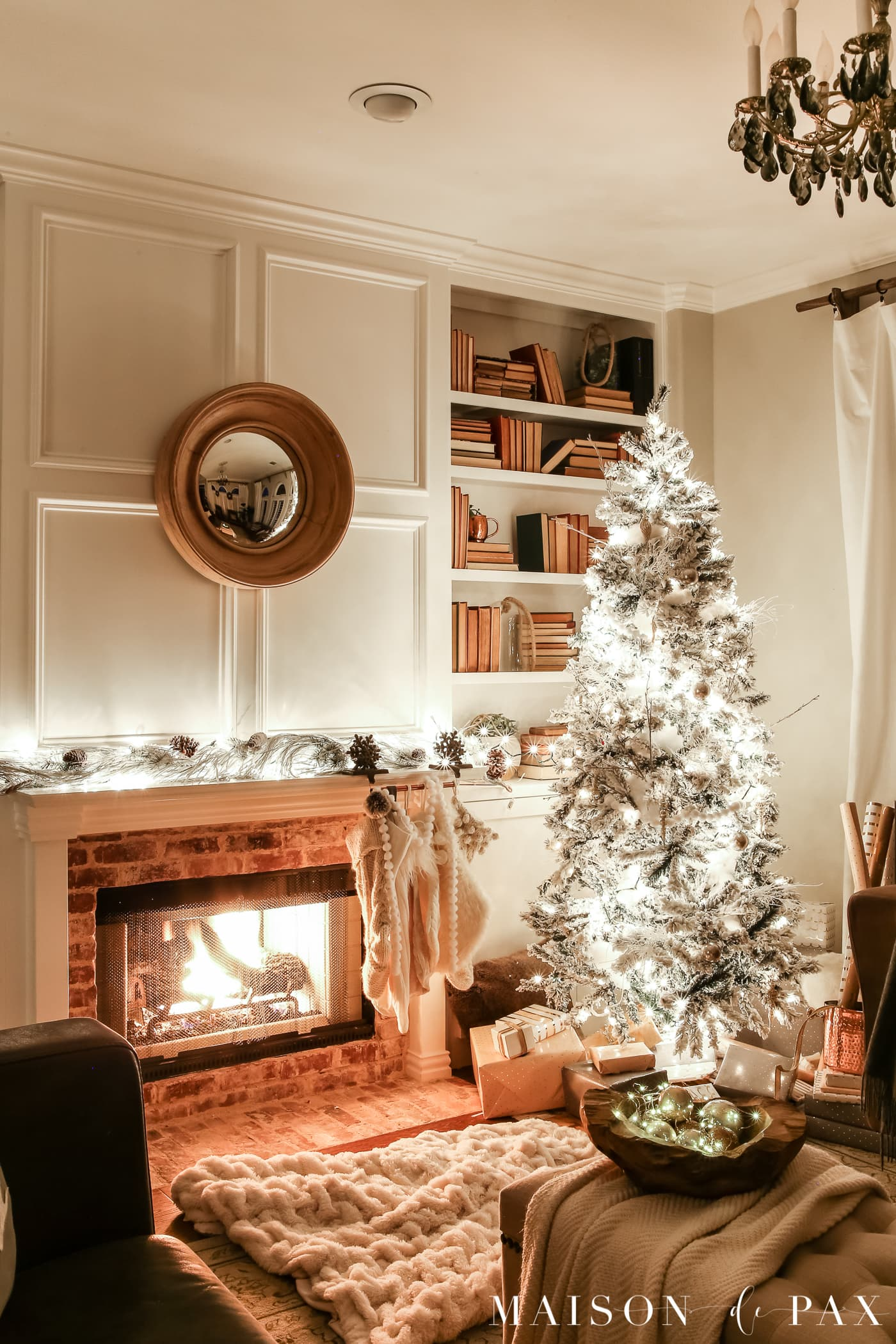 white stockings and tree: gorgeous Christmas lights at night in these 25+ home tours #christmasnightstour #holidayhometour #christmaslights