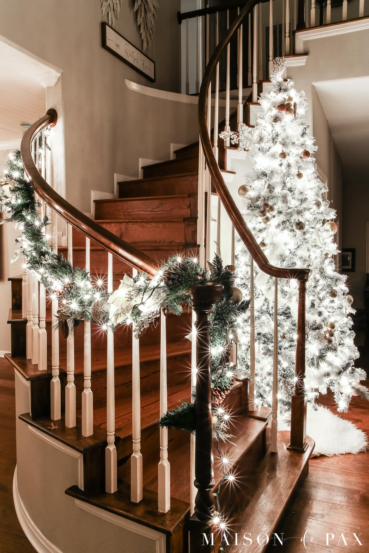 tall tree and wrap around spiral staircase: gorgeous Christmas lights at night in these 25+ home tours #christmasnightstour #holidayhometour #christmaslights