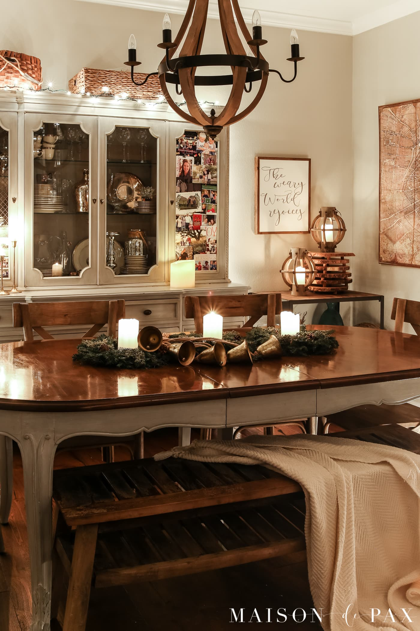 french farmhouse dining table with simple natural centerpiece: gorgeous Christmas lights at night in these 25+ home tours #christmasnightstour #holidayhometour #christmaslights
