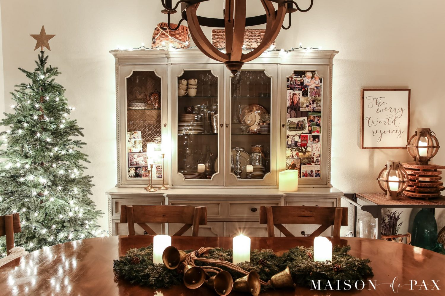 china cabinet strung with lights: gorgeous Christmas lights at night in these 25+ home tours #christmasnightstour #holidayhometour #christmaslights